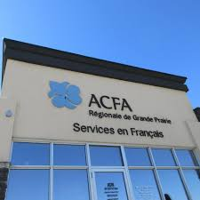 A beige building with purple logo ACFA Regionale de Grande Prairie