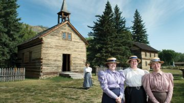 People stand outside the historic site of Historic Dunvegan in Fairview, Alberta.