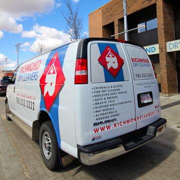 Van with logo at Richmond Dry Cleaners in Grande Prairie, Alberta.