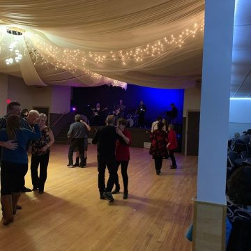 Couples dancing to a live band at the Bezanson Agricultural Society.