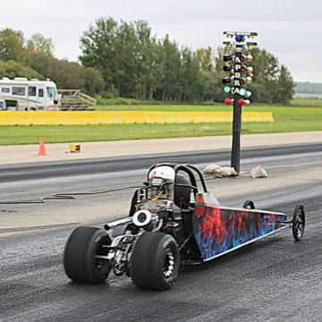 Black, blue, and red racing car at North Peace Bracket Racing Association.