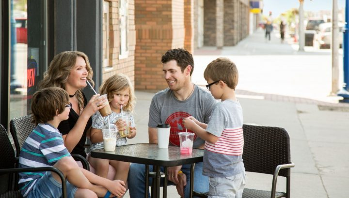 family outside of a cafe - fall fun in gp and region
