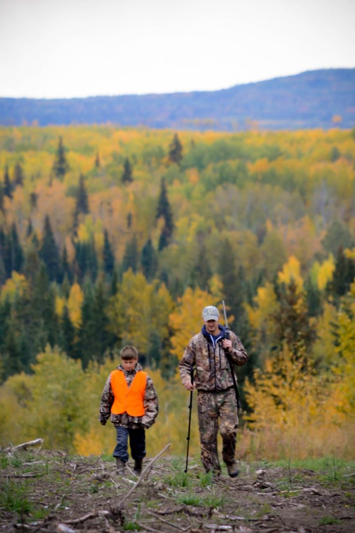 man and boy hunting in woods - fall fun in gp and region