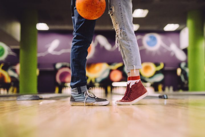 couple at a bowling alley for date night in gp