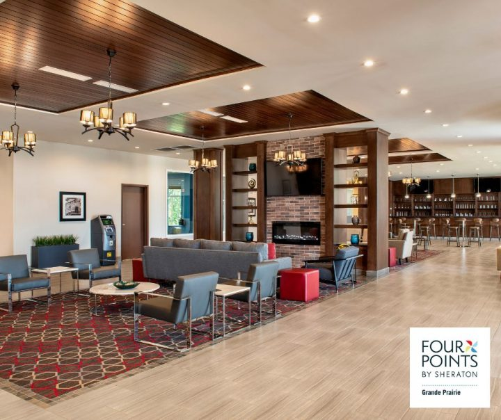 four points - hotel lobby with guest chairs