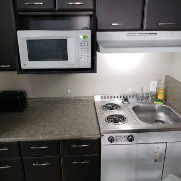 Kitchen area at the Brookside Apartment Hotel in Grande Prairie, Alberta.