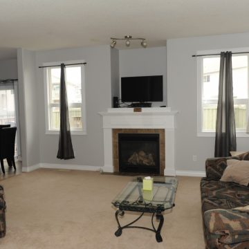 Living room and fireplace at Fresh Coast Investments in Grande Prairie, Alberta.