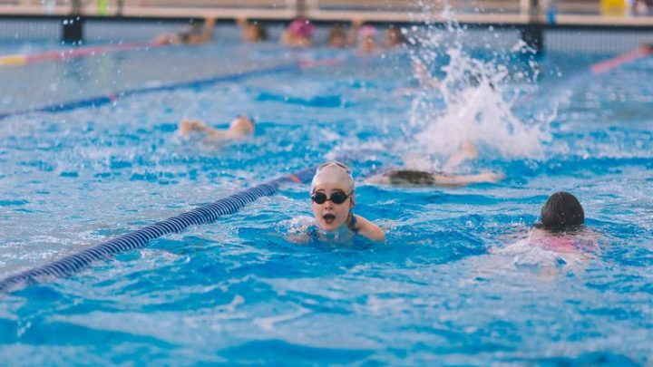 eastlink centre pool with people swimming - stay active indoors