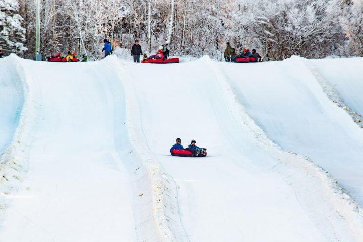 snowy escapades - winter tubing down hill