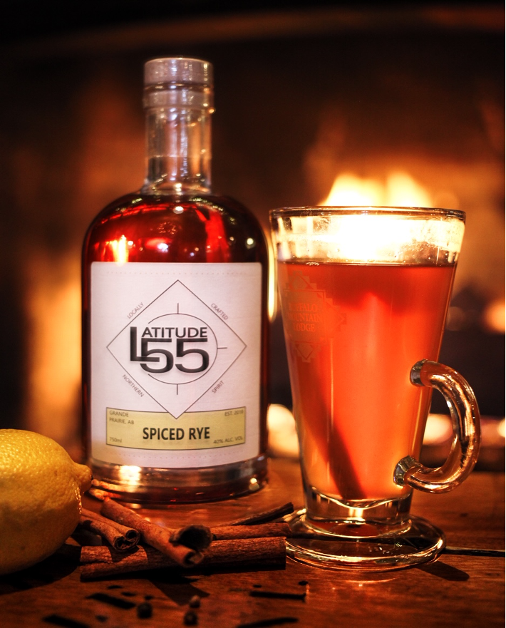 Latitude 55 spiced rye bottle and hot toddy drink