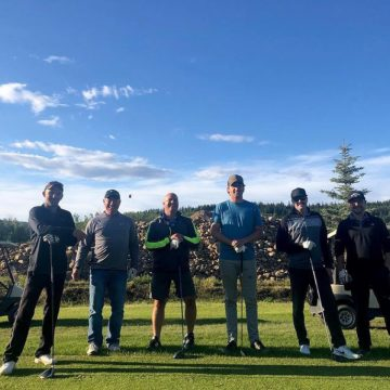 Men golfing at River Stone Golf Course.