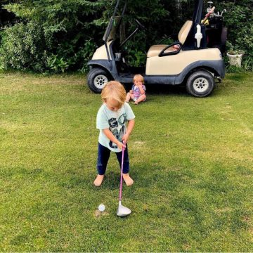 Child golfing at Riverstone Golf Course.