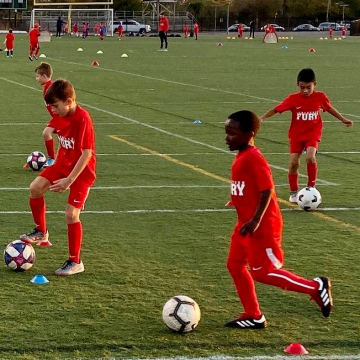 Children playing soccer at Swan City FC